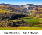 Spring time rural landscape. Railroad winds through agricultural fields in Carpathian mountains - stock photo