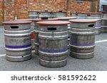 old beer kegs standing on the...