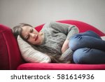 young girl with stomach pain... | Shutterstock . vector #581614936