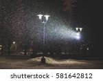 snowfall at park with shining... | Shutterstock . vector #581642812