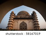Golgumbaz, a Mughal mausoleum in Bijapur, India is framed by its entrance arch. - stock photo