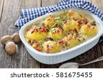 hearty potato dumpling  gratin... | Shutterstock . vector #581675455