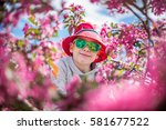 a smiling toddler boy in a... | Shutterstock . vector #581677522