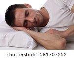 young handsome man sleeping... | Shutterstock . vector #581707252