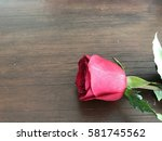 red flower with the wooden... | Shutterstock . vector #581745562