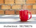 hot morning coffee in red mug | Shutterstock . vector #581788276