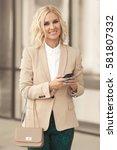 beautiful business woman in... | Shutterstock . vector #581807332