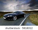 aston martin db9s under a... | Shutterstock . vector #5818312