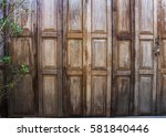 Small photo of old wooden accordion door background texture