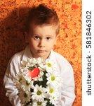little boy with a bouquet of... | Shutterstock . vector #581846302