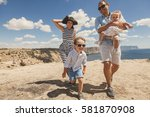 happy family of four walking in ... | Shutterstock . vector #581870908