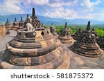 stupas and statue of buddha at... | Shutterstock . vector #581875372