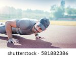picture of a young sportsman... | Shutterstock . vector #581882386
