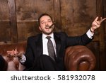 rich businessman with cigar... | Shutterstock . vector #581932078