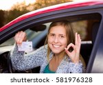 smiling woman holding her... | Shutterstock . vector #581976328