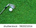 golf ball and golf club on... | Shutterstock . vector #582021016