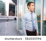 funny young businessman mocking | Shutterstock . vector #582035596