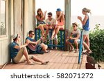 friends hanging out on vacation ... | Shutterstock . vector #582071272