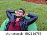 portrait of young arab... | Shutterstock . vector #582116758