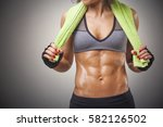 cropped image of a fit woman... | Shutterstock . vector #582126502