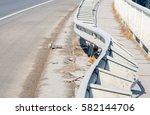 damaged fence on the bridge... | Shutterstock . vector #582144706