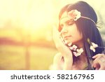 cute young woman with blooming... | Shutterstock . vector #582167965