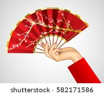 woman's hand with open chinese... | Shutterstock . vector #582171586