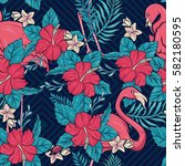 hawaiian floral and flamingos... | Shutterstock .eps vector #582180595