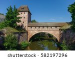 old city walls with an arch...   Shutterstock . vector #582197296