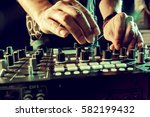 dj playing music at mixer... | Shutterstock . vector #582199432