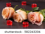 Three Beige Rose With Candles...