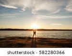 honeymooners on ocean or sea... | Shutterstock . vector #582280366