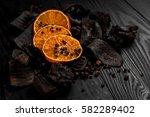 dried orange slices on wood... | Shutterstock . vector #582289402