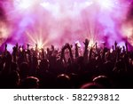 cheering crowd at a rock concert | Shutterstock . vector #582293812