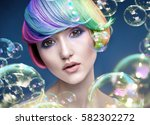 color haired young woman with... | Shutterstock . vector #582302272