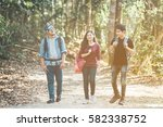 asian traveler with friends ... | Shutterstock . vector #582338752