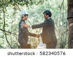 forman and businessman greeting ... | Shutterstock . vector #582340576