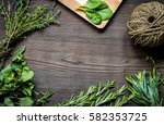 fresh herb frame on dark wooden ... | Shutterstock . vector #582353725