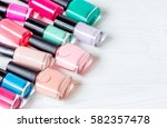 bottles of colored nail polish... | Shutterstock . vector #582357478