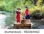 kids dressed in pirate costumes ... | Shutterstock . vector #582364462