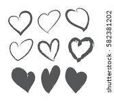 black brush stroke hearts set.... | Shutterstock .eps vector #582381202