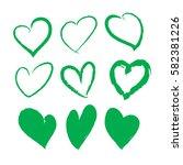 green brush stroke hearts set.... | Shutterstock .eps vector #582381226