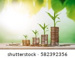 coin stacks on a green...   Shutterstock . vector #582392356