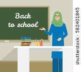 arab woman stands near the... | Shutterstock .eps vector #582401845