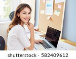 successful young woman sitting... | Shutterstock . vector #582409612