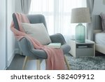 gray easy armchair with pink... | Shutterstock . vector #582409912