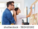 two designers brainstorming new ... | Shutterstock . vector #582410182