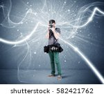a young amateur photographer... | Shutterstock . vector #582421762