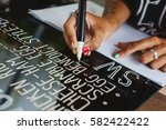 young woman writing cafe menu... | Shutterstock . vector #582422422