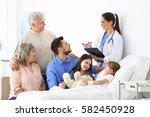 family visiting little girl in... | Shutterstock . vector #582450928